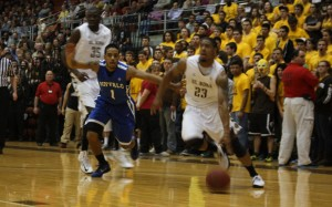Chris Johnson drives to the hoop for two of his 14 points against Buffalo - Photo by Daulton Sherwin