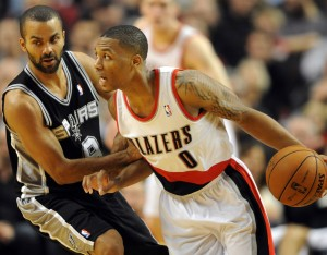 Damian Lillard (0) dribbles the ball past San Antonio Spurs point guard Tony Parker (9) during the fourth quarter of the game at the Rose Garden. Lillard scored 29 points as the Blazers won the game 98-90. (Steve Dykes-USA TODAY Sports)