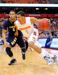 Syracuse Orange guard Michael Carter-Williams (1) drives to the basket around Canisius Golden Griffins guard Reggie Groves (5) during the second half at the Carrier Dome. (Photo by Rich Barnes-USA TODAY Sports)