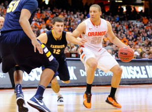 Syracuse Orange guard Brandon Triche (20) drives to the basket around Canisius Golden Griffins guard Billy Baron (12) during the second half at the Carrier Dome. Syracuse defeated Canisius 85-61. (Photo by Rich Barnes-USA TODAY Sports)