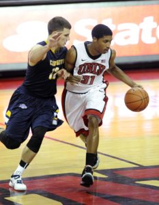 UNLV Runnin' Rebels guard Justin Hawkins (31) dribbles the ball as Canisius Golden Griffins guard Billy Baron (12) defends during the second half at the Thomas and Mack Center. UNLV defeated Canisius 89-74. (Photo by Josh H. Holmberg-USA TODAY Sports)