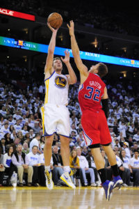 Golden State Warriors power forward David Lee (10) shoots the ball against Los Angeles Clippers power forward Blake Griffin (32) during the third quarter at Oracle Arena. The Warriors defeated the Clippers 115-94. (Photo by Kyle Terada-USA TODAY Sports)