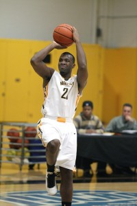 Zimmerman (21) attacking the basket earlier this season. Photo courtesy of Courtesy of Monroe Community College Athletics/Jamie Germano