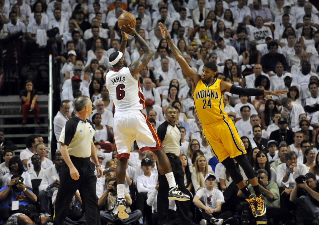 Miami Heat small forward LeBron James (6) shoots against Indiana Pacers small forward Paul George (24) in game one of the Eastern Conference finals of the 2013 NBA Playoffs at American Airlines Arena. (Steve Mitchell-USA TODAY Sports)