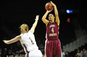 St. Joseph's (PA) Hawks guard Natasha Cloud (4) puts up a shot over St. Joseph's (PA) Hawks forward Ilze Gotfrida (1) during the first half of the 2013 A10 title game at the Barclays Center. (Photo by Joe Camporeale-USA TODAY Sports)