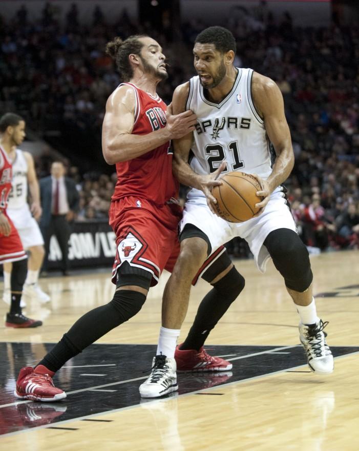 Bulls grind past sluggish Spurs