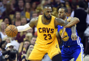 LeBron James (23) handles the ball against Golden State Warriors guard Andre Iguodala (9) during the second quarter in game four of the NBA Finals at Quicken Loans Arena. (Photo: Bob Donnan-USA TODAY Sports)