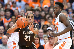Dion Wright (21) passes the ball around Syracuse Orange forward Tyler Roberson (21) during the first half at the Carrier Dome.  (Photo: Rich Barnes-USA TODAY Sports)