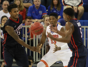 Terry Allen (15), forward Trey Davis (5) and Florida Gators forward Kevarrius Hayes (13) go after the ball during the first half at Stephen C. O'Connell Center. (Photo: Kim Klement-USA TODAY Sports)