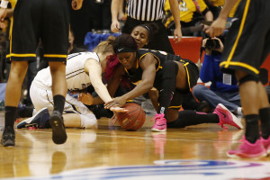 George Washington Colonials guard Hannah Schaible (20) and Virginia Commonwealth Lady Rams guard/forward Adaeze Alaeze (20) battle for loose ball in the third quarter during the women's Atlantic 10 Conference tournament at Richmond Coliseum. The Colonials won 72-58. (Photo: Geoff Burke-USA TODAY Sports)