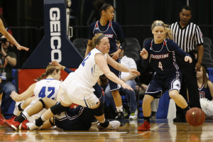 Saint Louis Billikens forward Olivia Jakubicek (12) and Duquesne Lady Dukes guard Chassidy Omogrosso (4) chase a loose ball in the second quarter in the women's Atlantic 10 Conference tournament at Richmond Coliseum. The Lady Dukes won 56-52. (Photo: Geoff Burke-USA TODAY Sports)