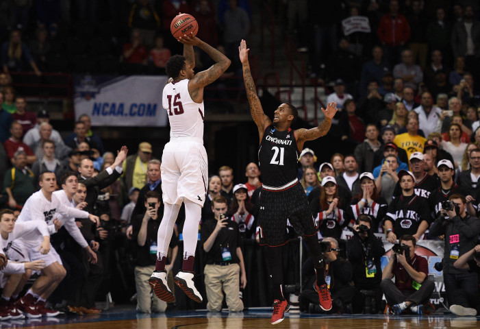 Miles connects on late three to send Saint Joseph's to second round