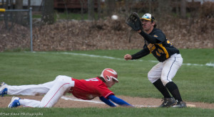 Fairport's Jeff Pratt dives in safely at first as Athena's Justin LoTemple covers the bag. (Photo: SUE KANE)