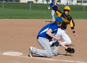 McQuaid's Nick Tomei slides in safely ahead of the tag at third by Bishop Kearney's Ian Pawluckie. (Photo by SUE KANE)