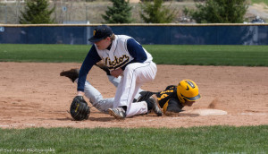 Christian Palawek (14) slides in safely at first ahead of the tag. (Photo: SUE KANE)