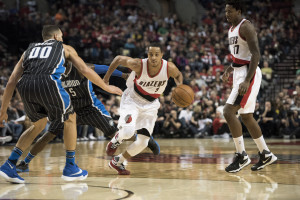 Portland Trail Blazers guard CJ McCollum (3) drives to the basket against Orlando Magic forward Aaron Gordon (00) at Moda Center at the Rose Quarter. (Photo: Troy Wayrynen-USA TODAY Sports)