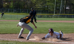 Johnny Mason slides in ahead of the pickoff attempt at first base. Morrie Silver (10) covers the bag for McQuaid. (Photo: SUE KANE)