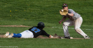 Batavia's Jerry Reinhardt slides back in safely ahead of the tag at first by Greece Arcadia's Kyle Bailey. Greece Arcadia defeated Batavia 13-0. (Photo: SUE KANE)