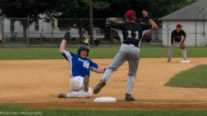 Hornell's Tanner Klein (26) slides in safe at third. Olean's David Hollins (11) waits for the throw. (Photo: SUE KANE)