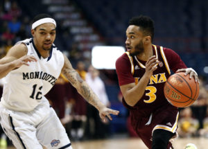 Iona's Ibn Muhammad (3) drives to the hoop against Monmouth's  Justin Robinson (12) during the first half of the MAAC conference tournament finals at Times Union Center. (Photo: Mark L. Baer-USA TODAY Sports)