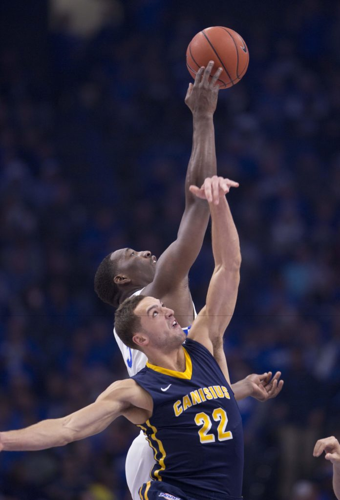 Aquinas alum Phil Valenti (22) battles for a rebound the Canisius season opener against then No. 2 Kentucky. (Photo : Mark Zerof-USA TODAY Sports)