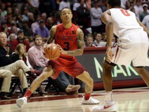 Dayton Flyers guard Kyle Davis (3) looks to give an entry pass into the post while being guarded by Alabama Crimson Tide's  Nick King (0)  at Coleman Coliseum. (Photo Marvin Gentry-USA TODAY Sports)