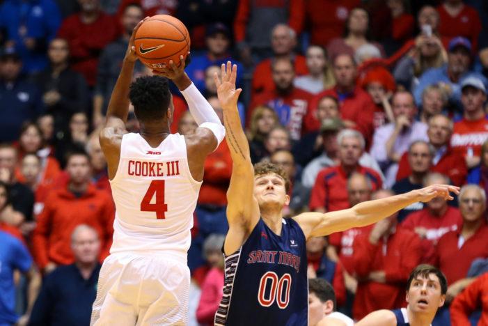 Cooke shoulders brunt of Dayton's scoring load