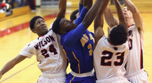 Players battle for a rebound during Tuesday's non-league game. Irondequoit beat Wilson, (Photo:Ron Kalasinskas)