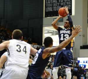 Dec 19, 2015; Washington, DC, USA; St. Peter's Peacocks guard Antwon Portley (13) shoots against the George Washington Colonials during the second half at Charles E. Smith Center. Mandatory Credit: Brad Mills-USA TODAY Sports