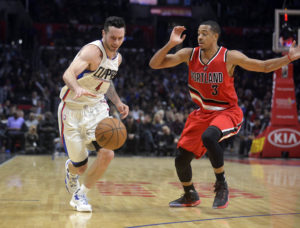 Los Angeles Clippers guard J.J. Redick (4) moves the ball against Portland Trail Blazers guard C.J. McCollum (3) during the second half at Staples Center. (photo: Gary A. Vasquez-USA TODAY Sports)