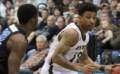 Adams, Bona hang on to beat UB