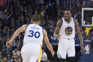 Kevin Durant (35) celebrates with Stephen Curry (30) during the third quarter against the Cleveland Cavaliers at Oracle Arena. The Warriors defeated the Cavaliers 126-91. (Photo: Kyle Terada-USA TODAY Sports)