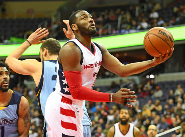 Wall leads Wizards to 13th straight home victory