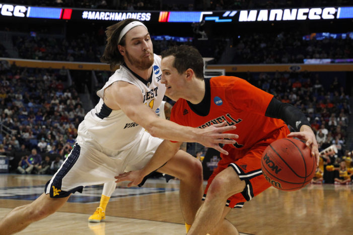 West Virginia holds off Bucknell to set up meeting with Notre Dame