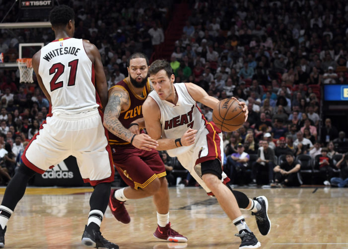 Heat still in contention with overtime win