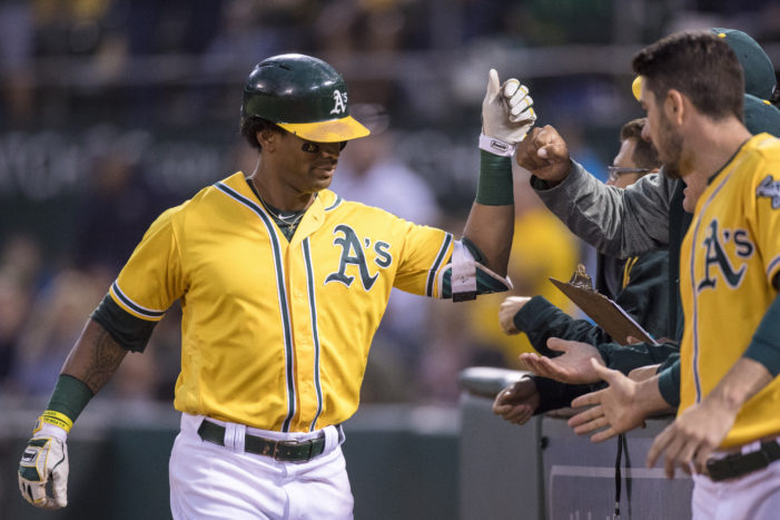 MLB Roundup: A's re-Joyce, Santana leads power surge and AL wild card tightens