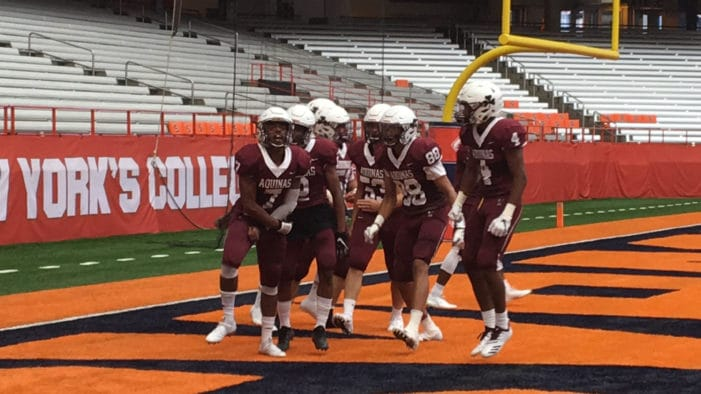 Robinson, Szalkowski lead Aquinas to season-opening win in Carrier Dome