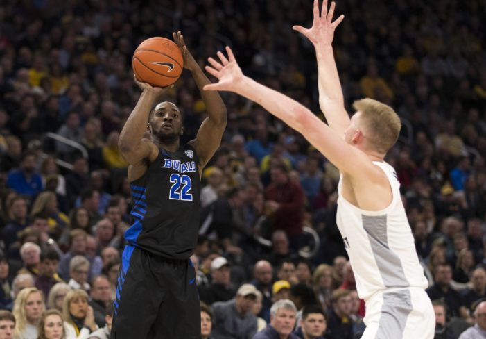 Hot-shooting No. 20 Marquette hands UB first loss of season